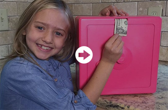 Young girl putting bill in bank