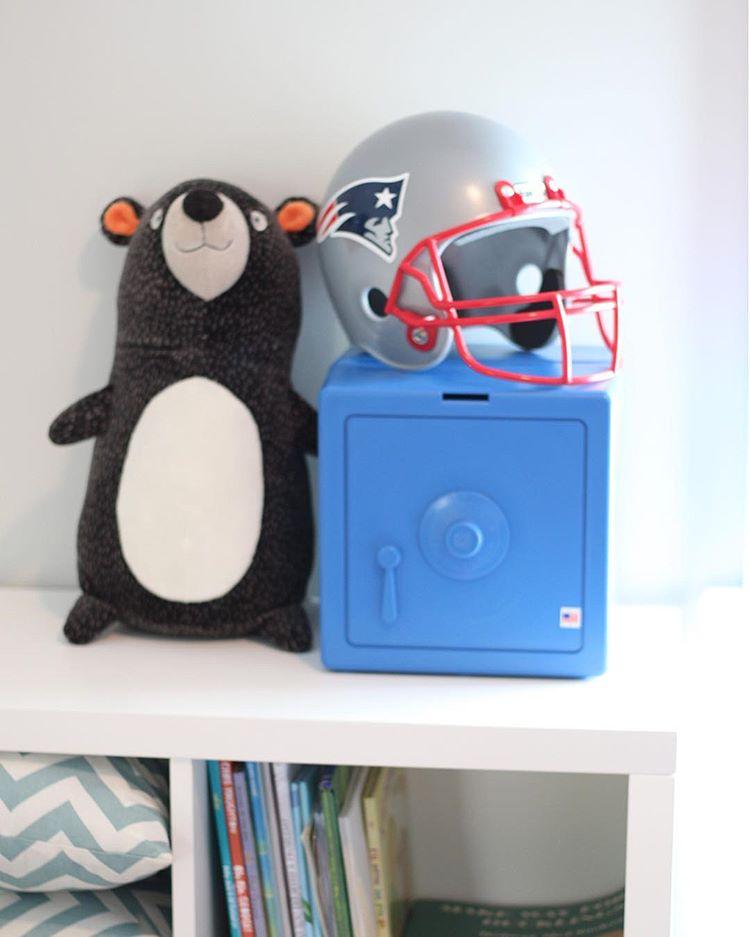 Blue Temptationless Bank on shelf beside stuffed bear